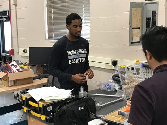 MTSU senior guard Ed Simpson works on a project in