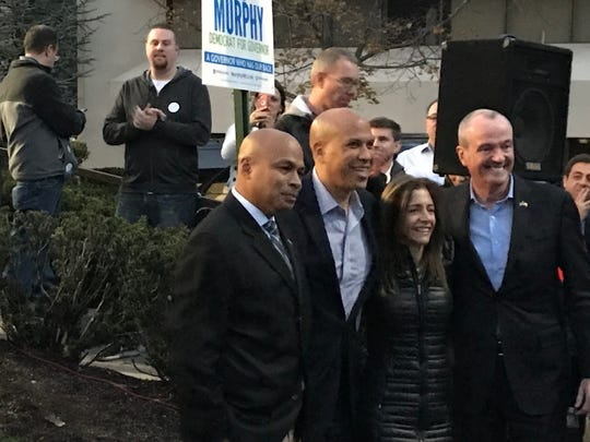 Parsippany mayoral candidate Michael Soriano, Sen. Cory Booker, Tammy Murphy and Phil Murphy before a rally at Phil Murphy campaign headquarters in Parsippany, four days before the election, on Nov. 4, 2017.