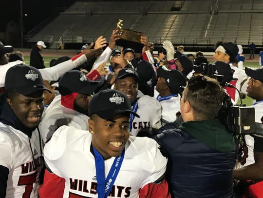 The Wilson Wildcats celebrate the first Section V football championship in the team's history in 2017.