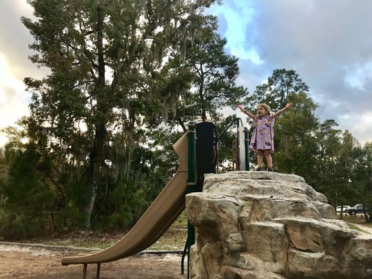 Avery Guidry, 3, sings that she's queen of the mountain on a playground at Sam Houston Jones State Park. She is joining her mom, travel and tourism reporter Leigh Guidry, and their family as they visit every Louisiana state park.