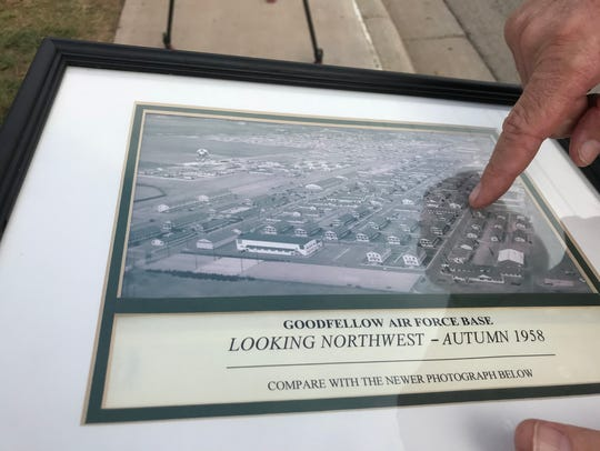 Historian John Garrett points out where the old movie theater stood as Ron Chicon looks at an old photo of  Goodfellow Air Force Base, where his father was stationed during World War II. His parents spent a lot of time together on the base, and Chicon returned to spread his mother's ashes on Monday, Nov. 6, 2017.