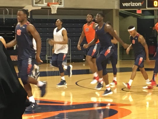 Auburn players Austin Wiley and Danjel Purifoy are