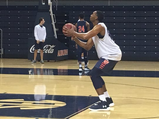Auburn players Austin Wiley shooting free throws during a Nov. 7 practice. Wiley is with the scout team during practice as his eligibility remains a mystery.