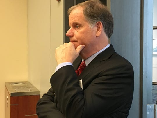 Doug Jones attends a voting rights panel in September.