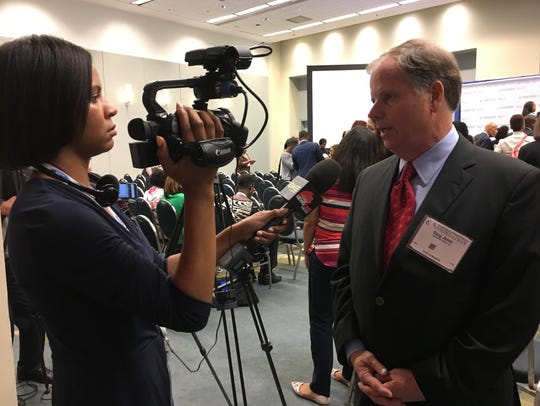 Doug Jones talked to reporters after a session at the