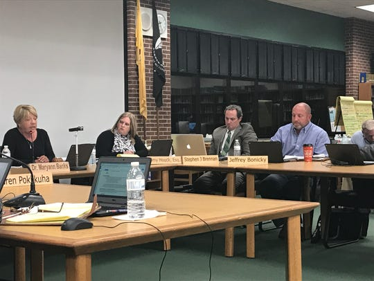 File photo: Pinelands Regionals officials, from left to right, Board of Education President Susan M. Ernst, attorney Amy Houck, Business Administrator Stephen Brennan, and board member Jeffrey Bonicky, are shown Nov. 6, 2017.
