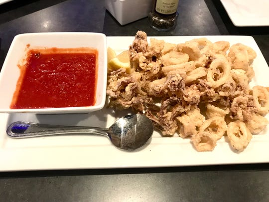 Fried calamari ($10.99) is lightly floured and deep-fried, mild, medium or hot, served with marinara sauce.