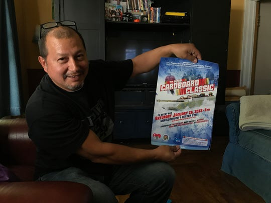 Dan Guerrero shows a flier for the Cardboard Classic
