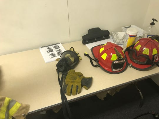 Equipment used to protect firefighters in active infernos sits on a table in a portable classroom at Abilene High School, where former Abilene Fire Department Lt. Mike Miller is teaching a future group of firefighter students.