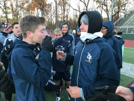 NV/Old Tappan players took turns kissing the championship