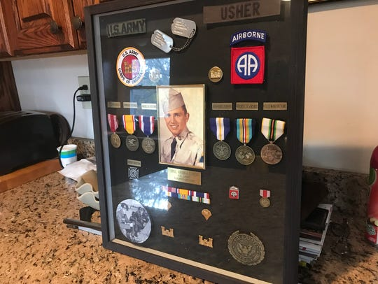 Thom Usher keeps the medals he received from his service