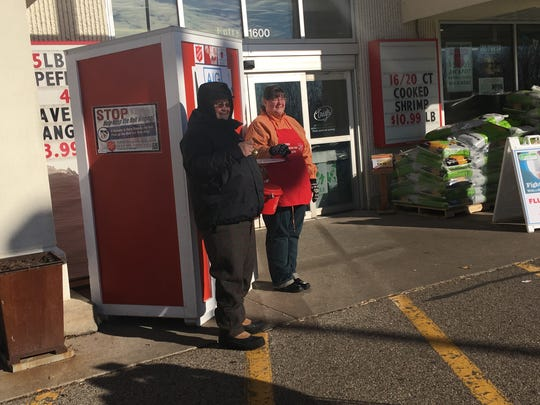 Representatives from AIG ring bells outside of Trig's in Stevens Point on Nov. 10., 2017.