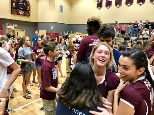 The First Baptist Academy volleyball team celebrates its 3-1 win over Jupiter Christian to head to the 3A state championship on Saturday, Nov. 11, 2017.