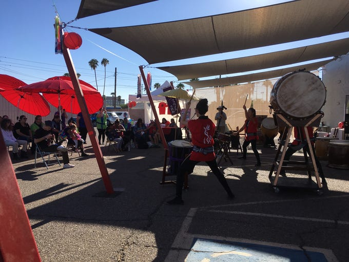 Taiko drum performances reverberated down the street