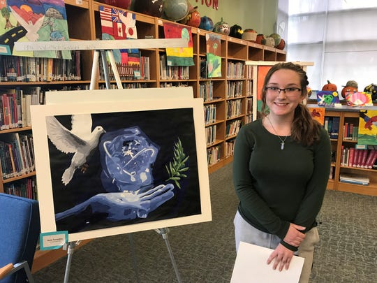 Jacie Tompkins, a Spencer Middle School student, won the local Spencer-Candor Lions Club Peace Poster Contest. Her painting then went to the 20-E2 Fall Conference on Nov. 4 in Geneva. Jacie's painting will now travel to New York City to be judged at the multi-district state level. Jacie's art teacher is Nicole McCarthy.