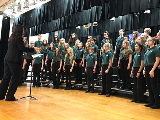 The Pioneer Middle School choir, under the direction of Anne Lawrence, performed the fight songs for all branches of the U.S. military.