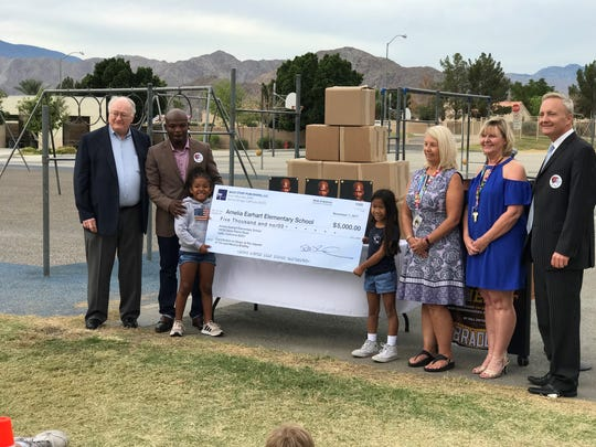 Boxer Tim Bradley (second from left) and his family present a donation to Amelia Earhart Elementary School in Indio.