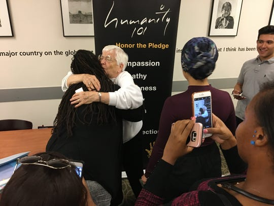 After speaking at Arizona State University, Jane Elliott took pictures with students. Here, she hugs Danielle Archey, of Houston, Texas.