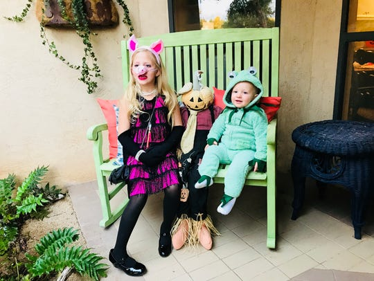 Miss Piggy and Kermit on Halloween. From left: Charley