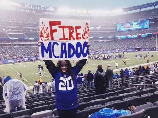 "Giants season ticket holder and West Milford resident Samantha Hollfelder, 18, holds a ""Fire McAdoo"" sign in Section 117 of MetLife Stadium during the team's 51-17 loss to the Los Angeles Rams in East Rutherford on Sunday, Nov. 5, 2017."