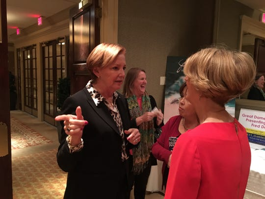 Ellen Kullman, former DuPont CEO, (left) speaks with