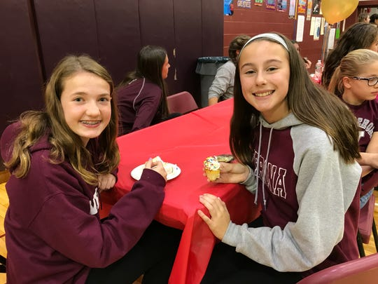 "Seventh-graders Kayla Mroz and Fernanda Webster, both 13, are inspired after ""Cake Boss"" Buddy Valastro visits H.B. Whitehorne Middle School on Nov. 15, 2017."
