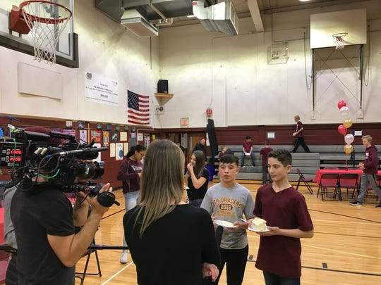 "Verona native Rachel Yeager interviews PJ Shaw and Nicholas Jacobsen, both 13, after ""Cake Boss"" Buddy Valastro visits H.B. Whitehorne Middle School on Nov. 15, 2017."