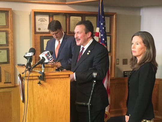 Hamilton County Board of Commissioners President Todd Portune announces on Wednesday the county's offer to FC Cincinnati to help pay for a stadium. From left to right, Commissioner Chris Monzel, Portune and Commissioner Denise Driehaus
