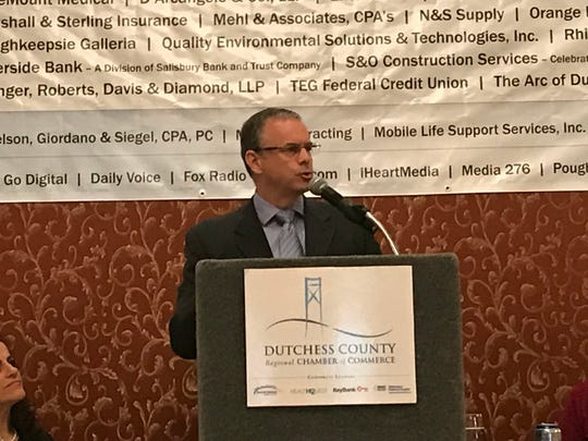 Joseph Collins, a principal vice president at Bechtel Infrastructure and Power Corp. and project manager for Cricket Valley, speaks at the Dutchess County Regional Chamber of Commerce's Wednesday breakfast meeting.