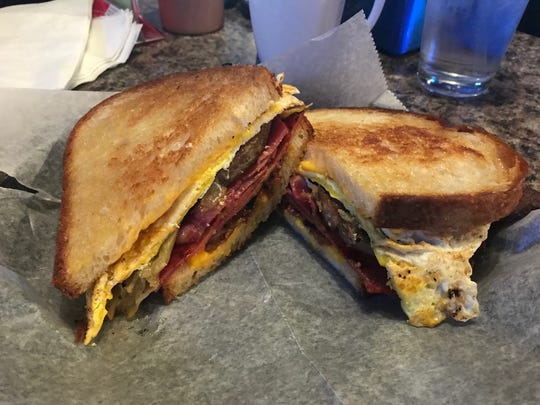 "The breakfast sandwich with ""all the meats"" (capicola,"