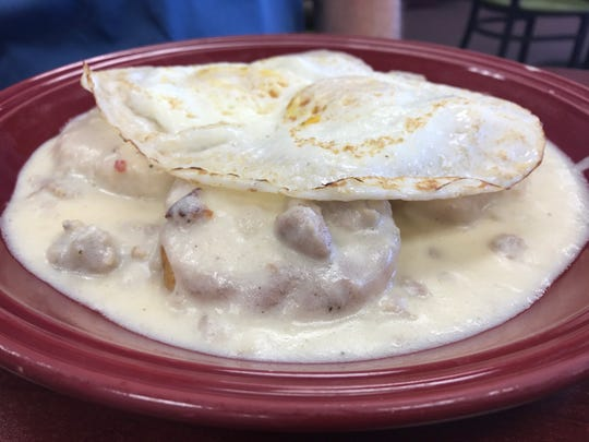 The biscuits and gravy with two eggs over-easy at PerKup Cafe.