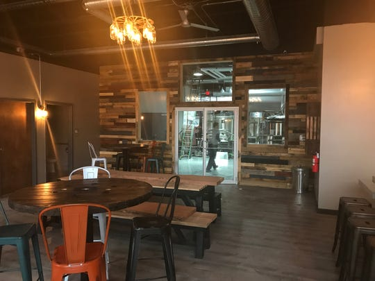 Spencerport's Brindle Haus Brewing features reclaimed pallet wood on the walls.