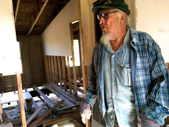 Zeke Romero, a resident of Copano Heights neighborhood, took on replacing the rotted floor of his home himself before volunteers stepped in to lend a hand.
