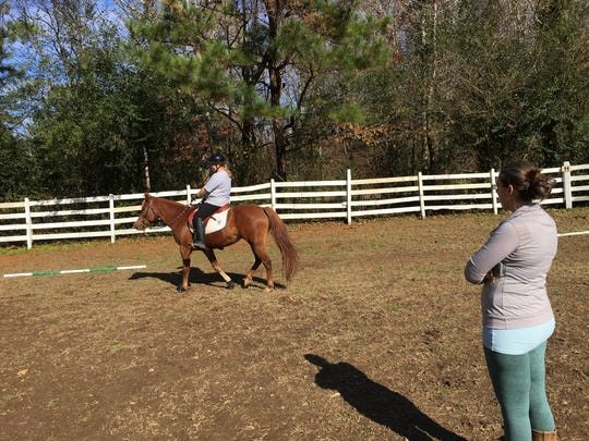 Kristi Kay May, right, watches and gives instructions to Shelby Shorty during a riding lesson at Legend Acres.