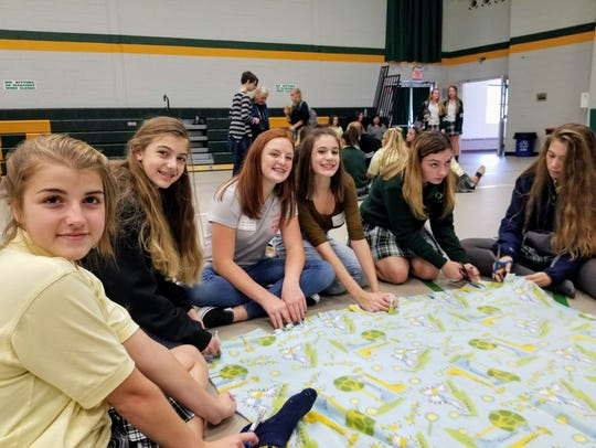 Our Lady of Mercy Academy's Interact Club, with a little