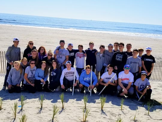 Brother-Sister Schools unite in service in Atlantic City. Our Lady of Mercy Academy and St. Augustine College Preparatory School were among the five schools that participated in this year's Project Green, an annual Interact Club service project which involves planting dune grass on the beach in Atlantic City.