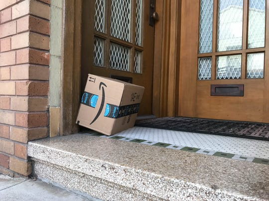 An Amazon package left on at a doorway.