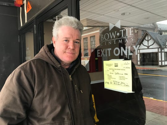 Montclair resident Michael O'Leary stands in front of the now-shut Bellevue Theater in Montclair.