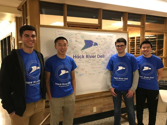 From left, Greg Sarafian, Sean Kee, Michael Vasile and Alexander Chu organize Hack River Dell at River Dell High School in Oradell on Nov. 18, 2017.