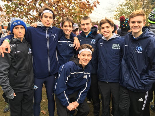 The Christian Brothers boys cross country team poses after winning the Meet of Champions