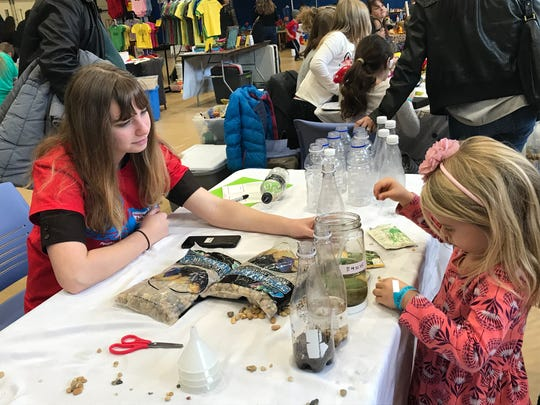 Poughkeepsie Day School's environmental club members teach children how to make their own garden.