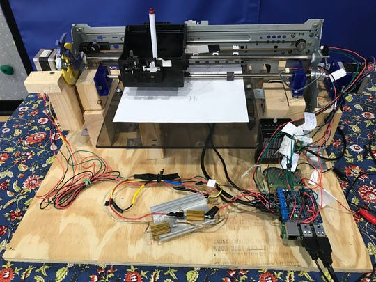 Nachman Kaul-Seidman's invention is called the X-Y Plotter, a printer from a salvaged inkjet printer.