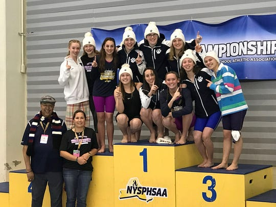 The Pittsford girls swim team celebrates its fourth