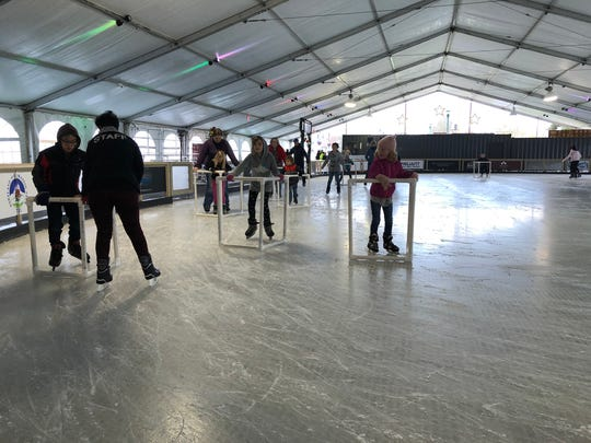 People skating at Salem On Ice, located at Riverfront