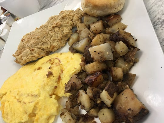 scrambled eggs and pork tenderloin, which was far bigger than expected, fried in a crisp, slightly peppery, non-greasy batter.