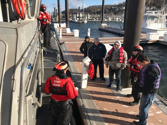 A Coast Guard Station Sandy Hook heavy weather boatcrew rescued four men who were stranded aboard a 22-foot vessel near Keansburg, New Jersey, November 19, 2017. The boatcrew arrived on scene and rescued the four boaters off of the unseaworthy vessel. The on scene weather was 30-knot winds and 3 to 5-foot sea state. (U.S. Coast Guard photo)