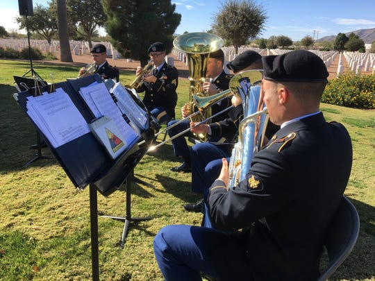 Members of the 1st Armored Division Band play during the German National Day of Mourning ceremony Sunday.