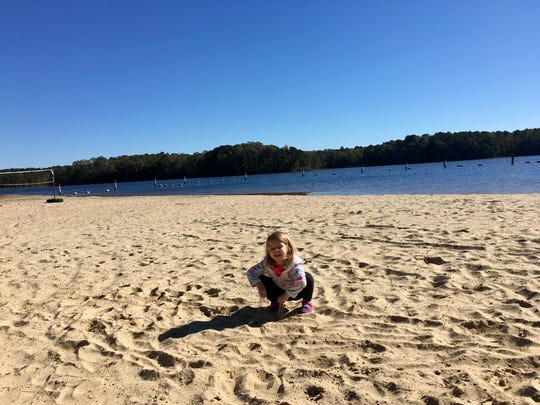 Avery Guidry, 3, checks out the beach on Caney Creek