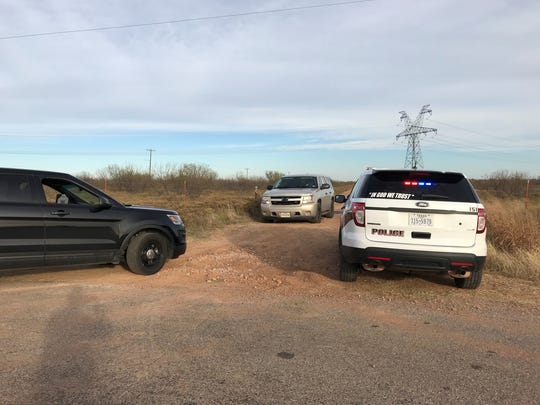 Law enforcement officials block off access to the scene of a reported helicopter crash Monday afternoon off U.S. Highway 287 Business near Electra.