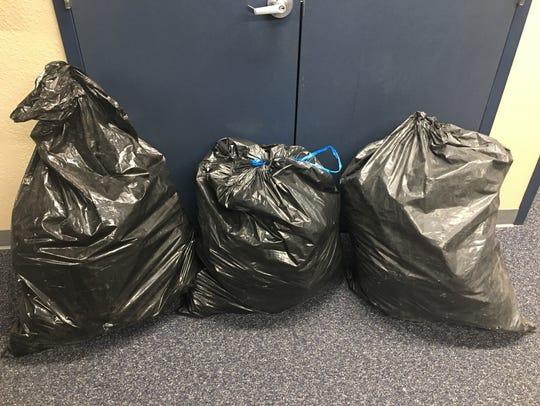 Dinuba police found three trash bags full of processed